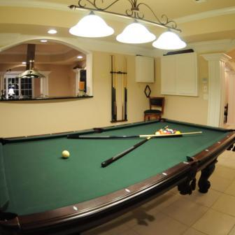 Pool room in Southern Basement Company basement finish.
